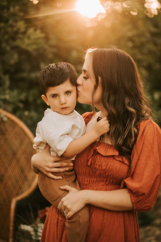 Mom kissing son on cheek