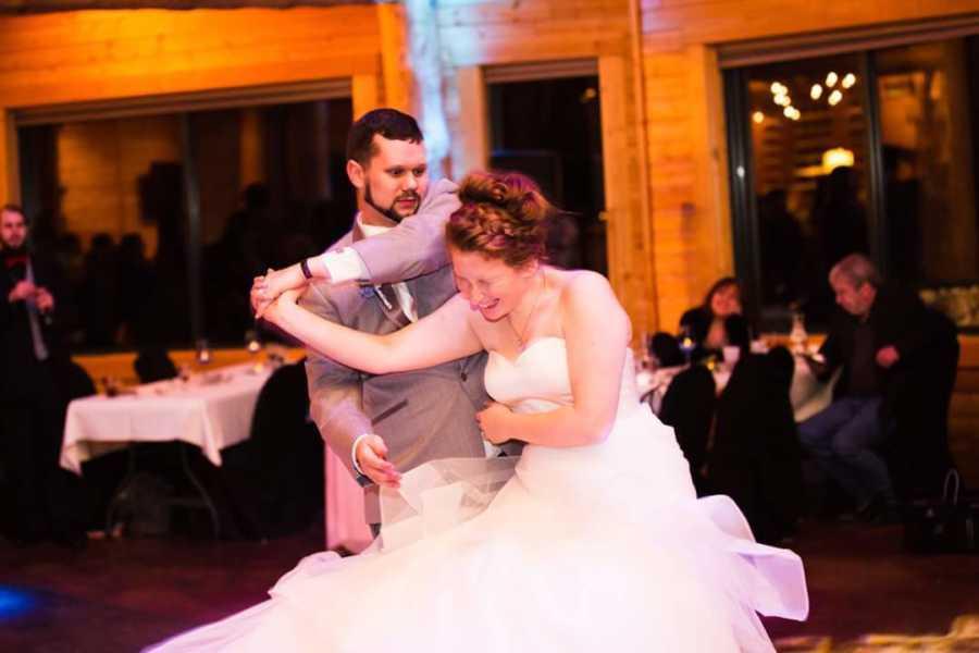 Wedding photo of bride and groom dancing