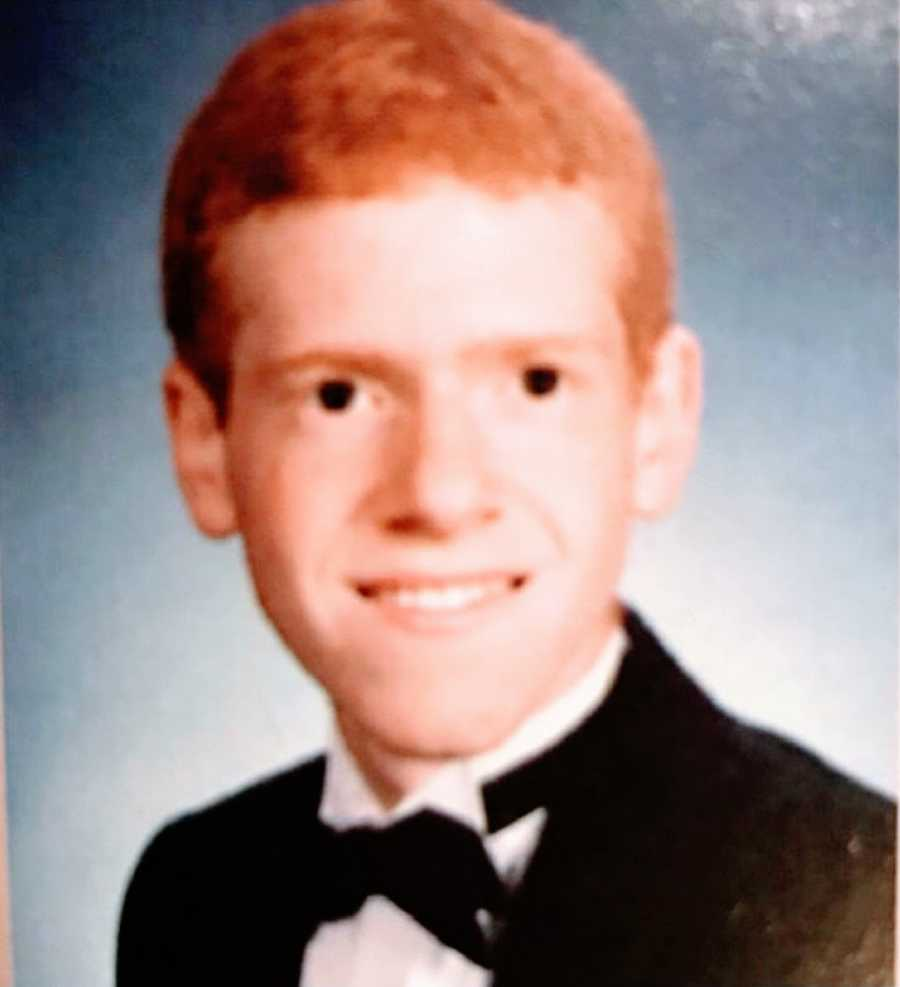 A young man with social anxiety in his high school yearbook photo