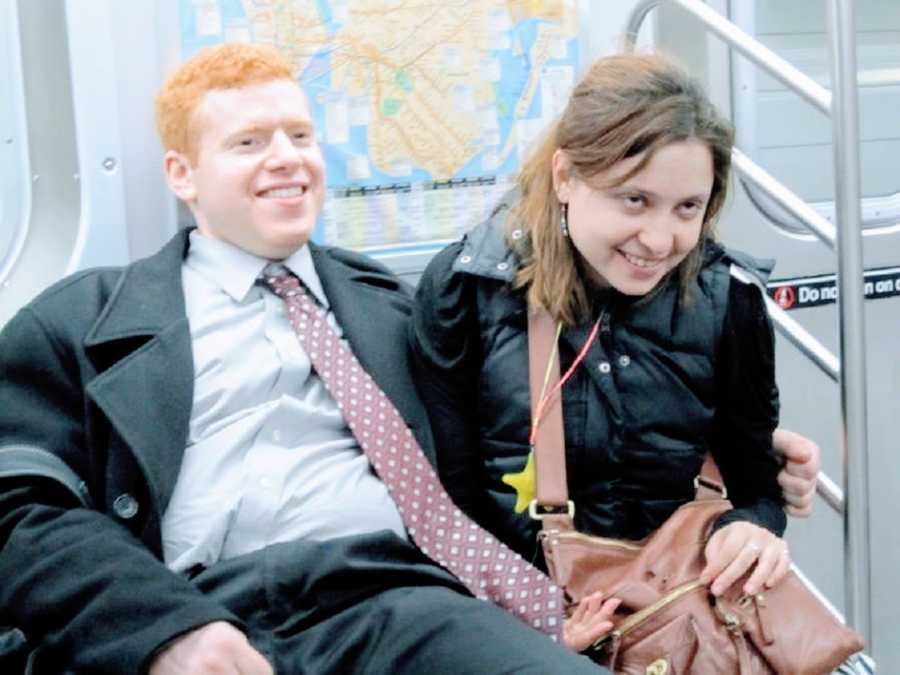 A comedian with social anxiety and his girlfriend sit together on a train