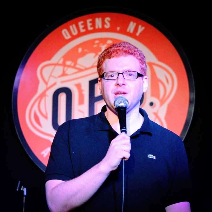 A stand-up comedian with social anxiety performs on stage