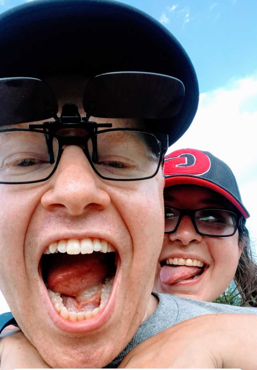 A comedian and his wife making silly faces at the camera
