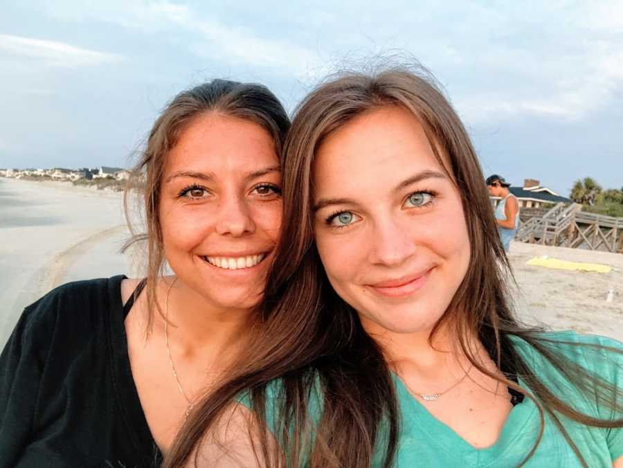 A young woman and her adopted sister on a beach
