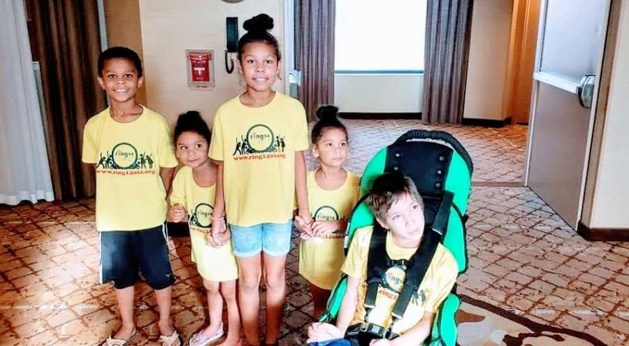 A boy with rare seizures sits with his four younger siblings, all wearing matching shirts