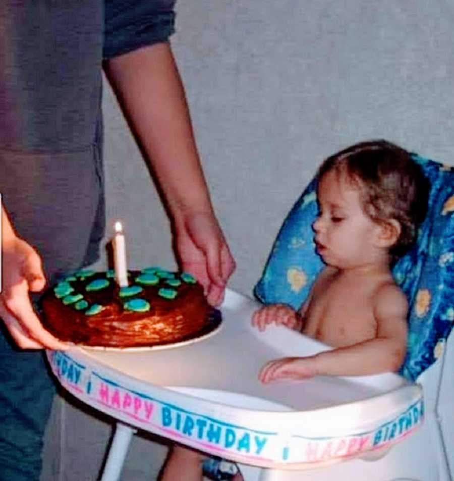 A boy with rare seizures sits in a high chair on his birthday