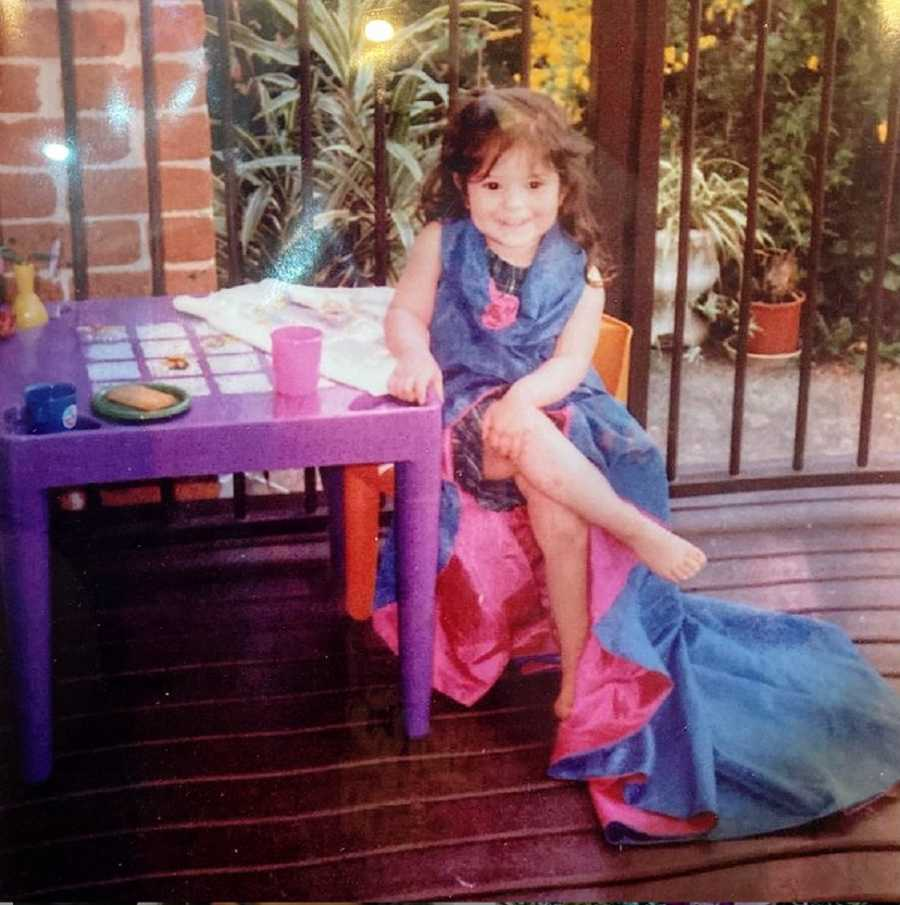 A young girl with undiagnosed ADHD sits at a purple plastic table