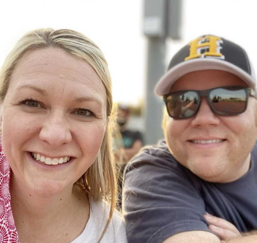 Husband and wife taking smiling selfie