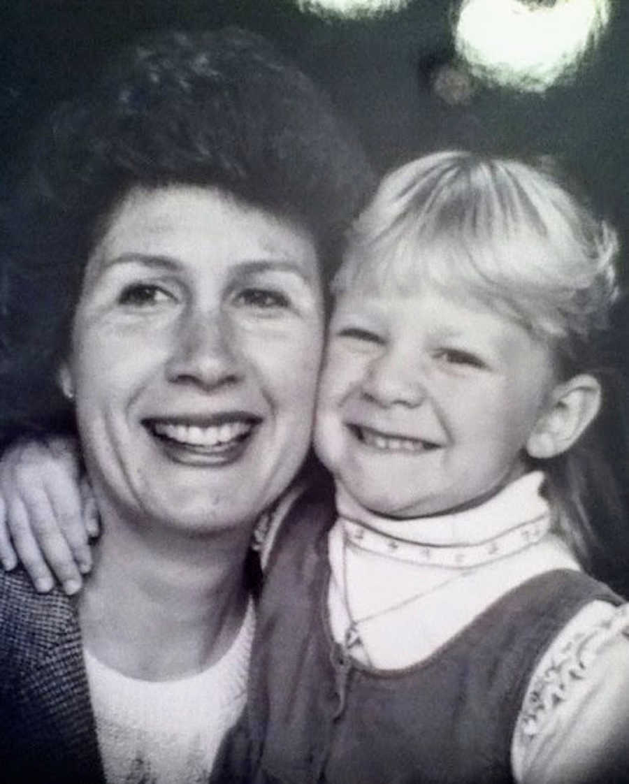 Black and white photo of mom and daughter with arms around each other