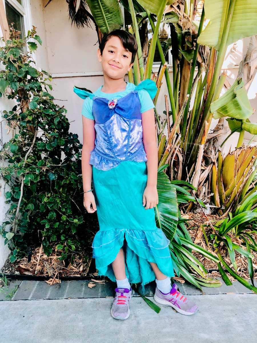 A boy wearing a mermaid costume
