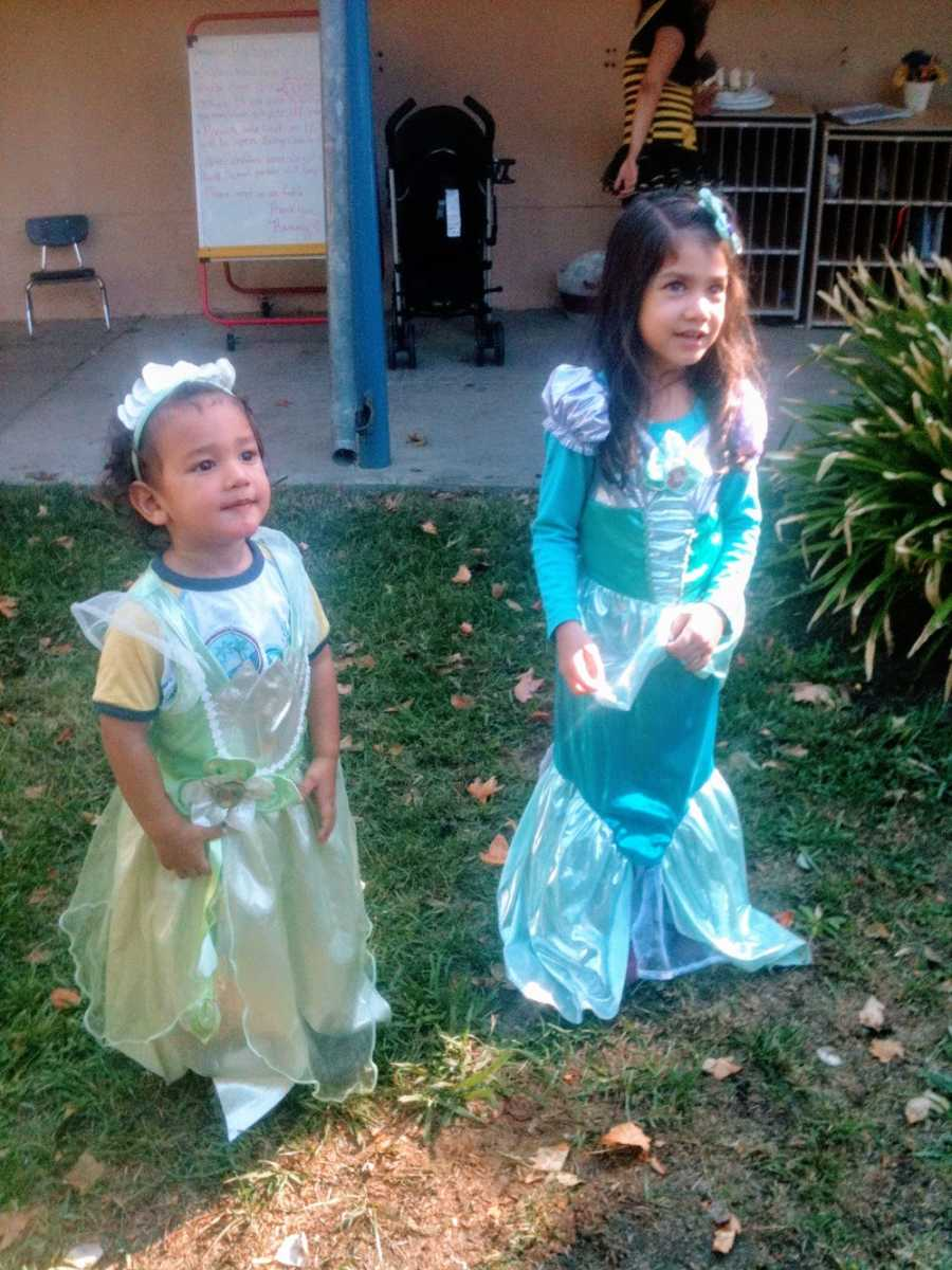 A little boy wears a princess costume and his sister wears a mermaid costume