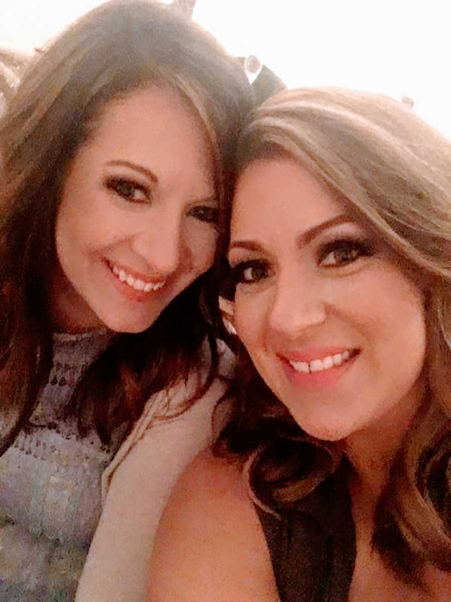 Two women with brown hair smiling