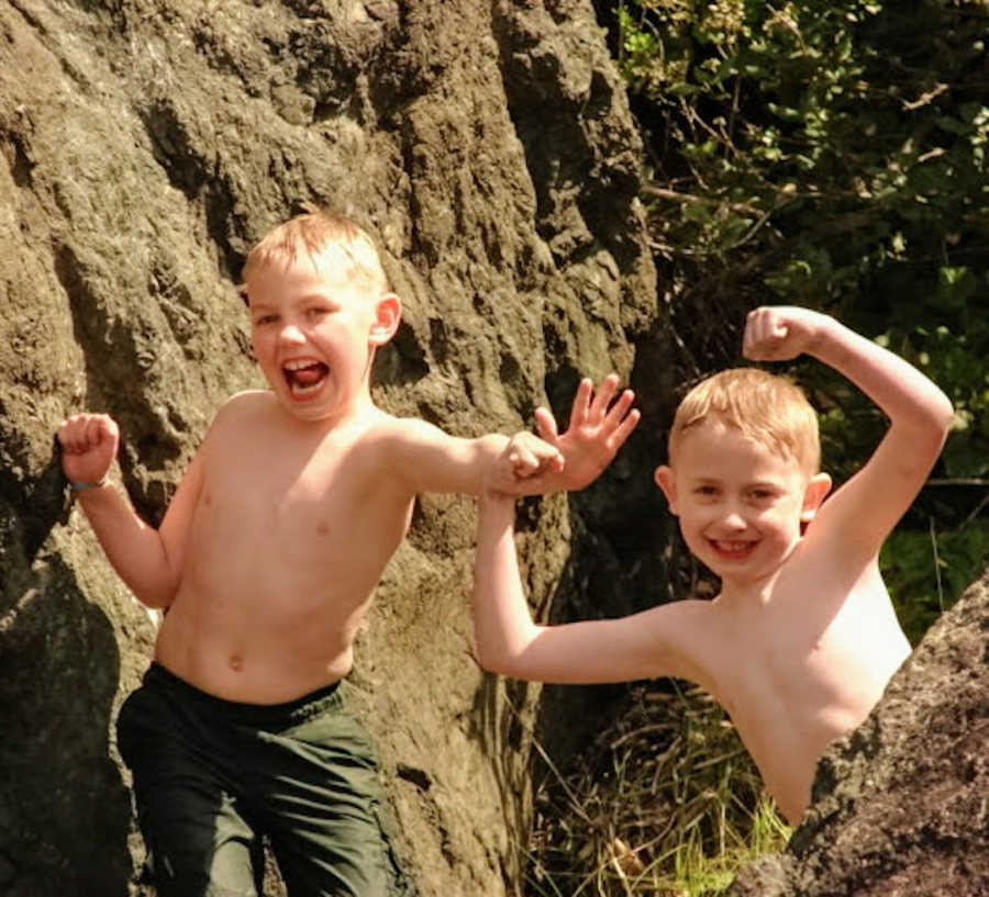 Two brothers after swimming doing funny poses