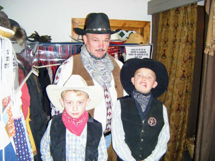 Father and sons dressed as cowboys