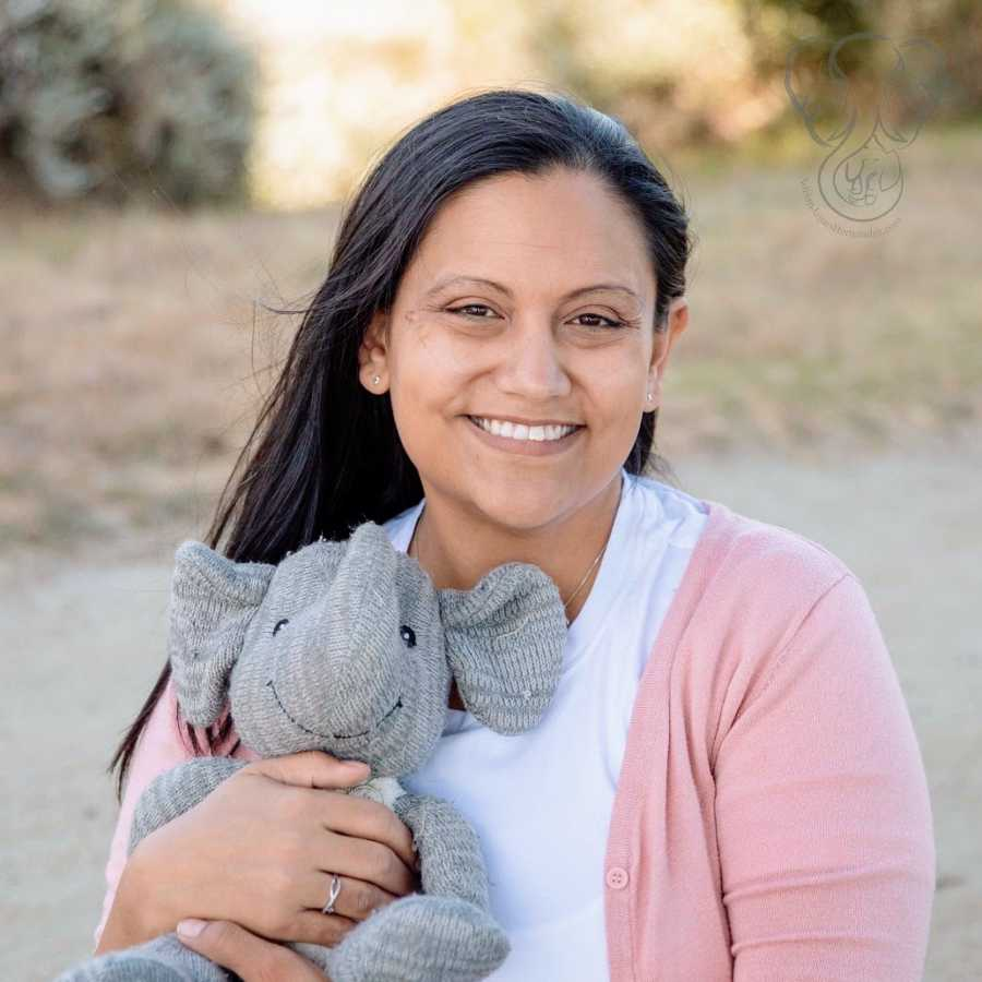 A single mother by choice holds her deceased son's toy elephant