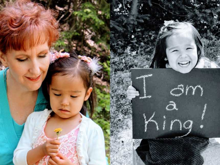 Mother holding daughter with dandelion in her hands and young girl holding up adoption sign