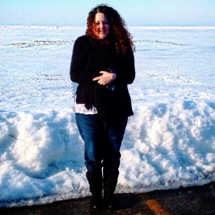 A woman struggling with her mental health stands out in the snow