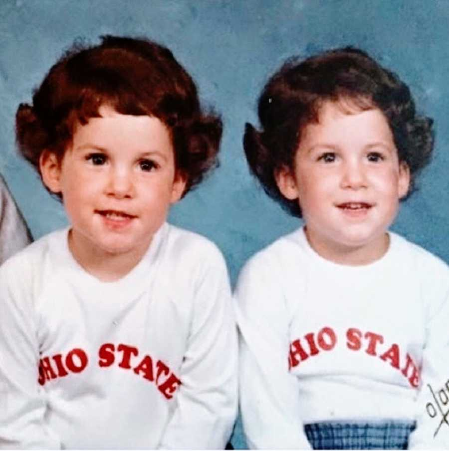 Twin girls with brown hair wearing white Ohio State shirts
