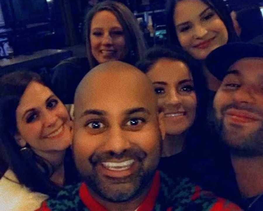 Group of people taking smiling selfie