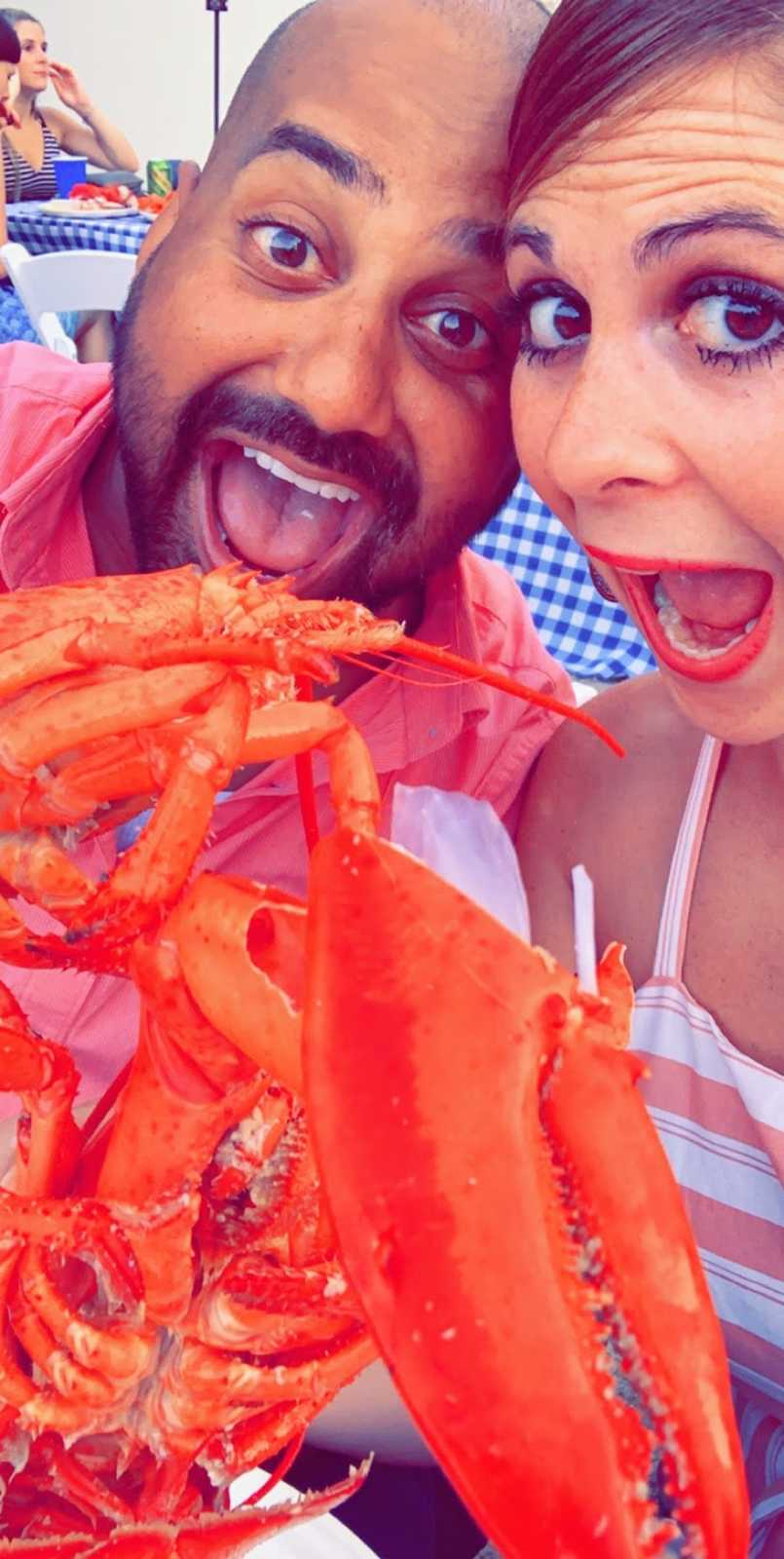 Man and woman looking at lobster