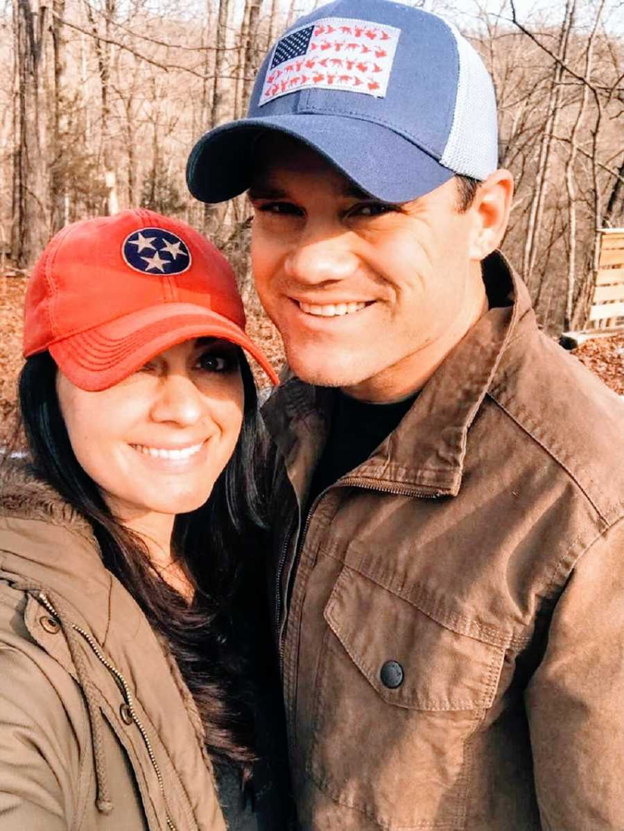A woman and her husband wearing ballcaps and brown jackets