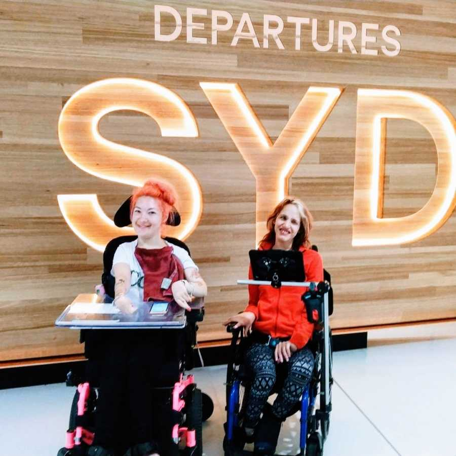 A woman with cerebral palsy and her friend at the airport