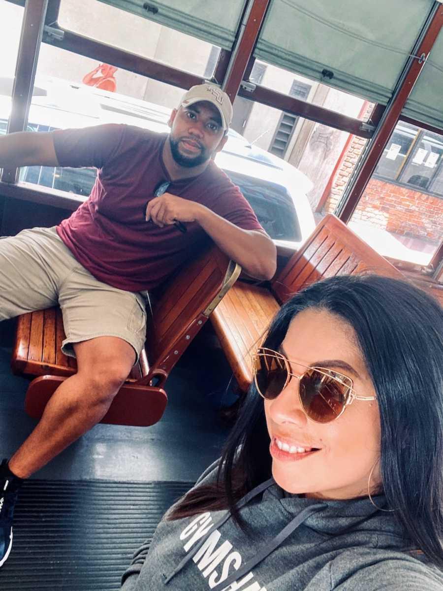 Couple sitting on bus taking selfie