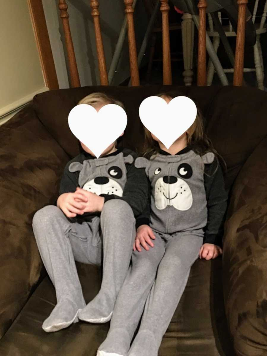 Foster siblings sitting on couch wearing matching pajamas