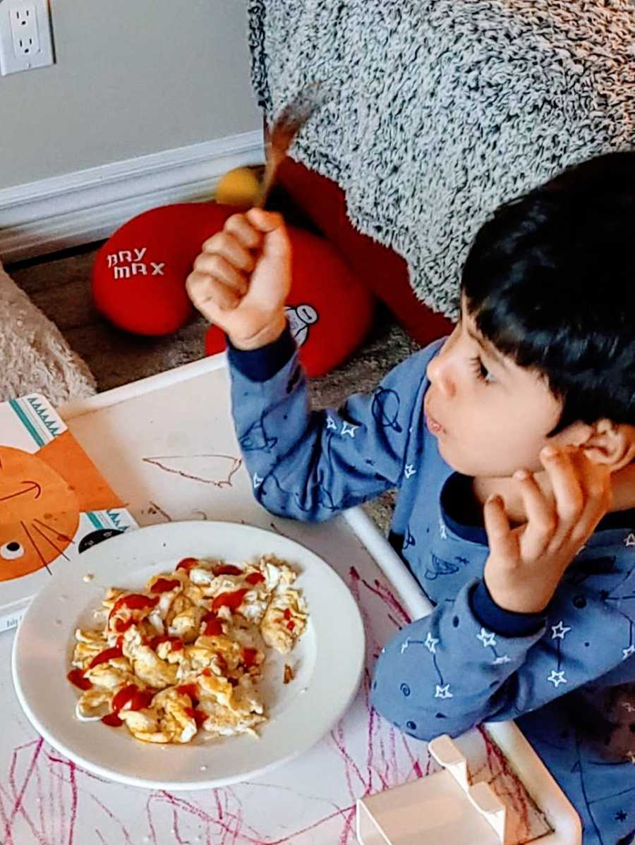 A young boy with autism eating a meal