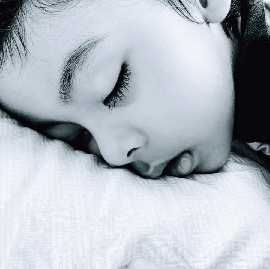 An autistic toddler sleeping