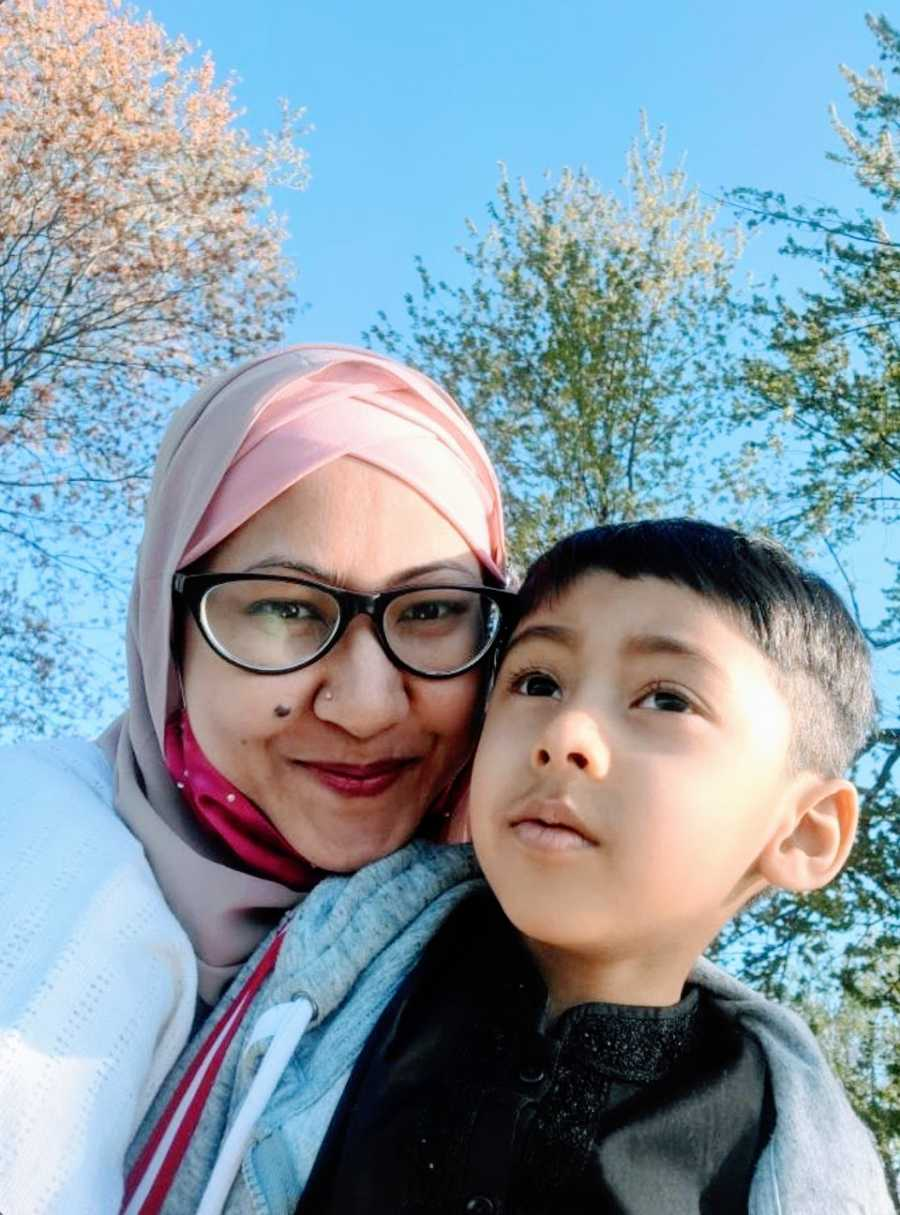 A neurodivergent mom and her son with autism outdoors