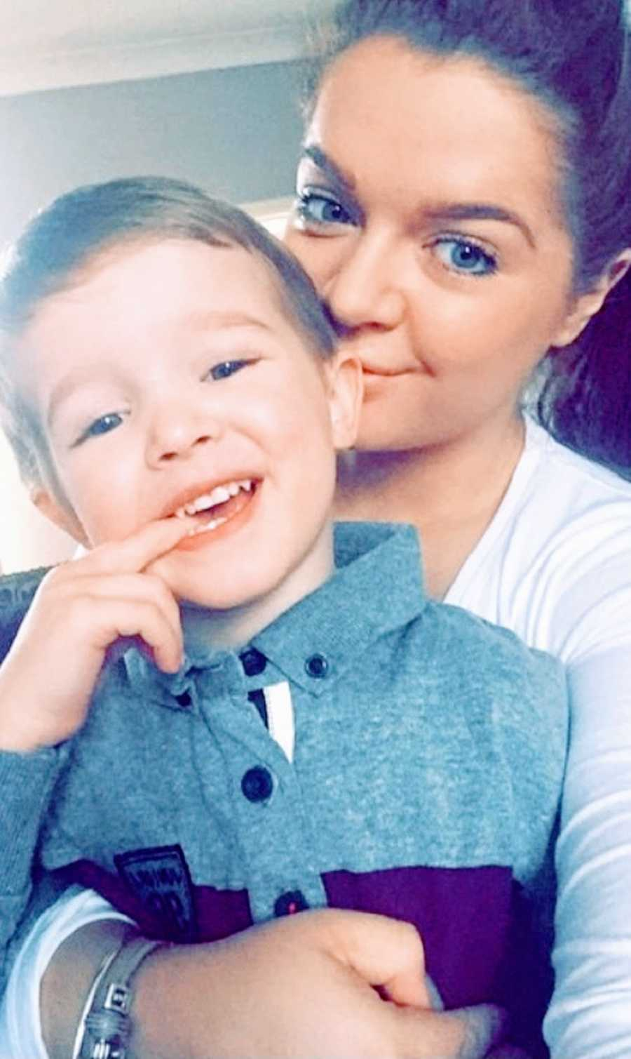 A woman with chronic illness holds her son