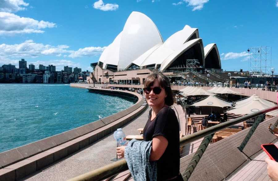 Woman standing in front of Sydney Opera House