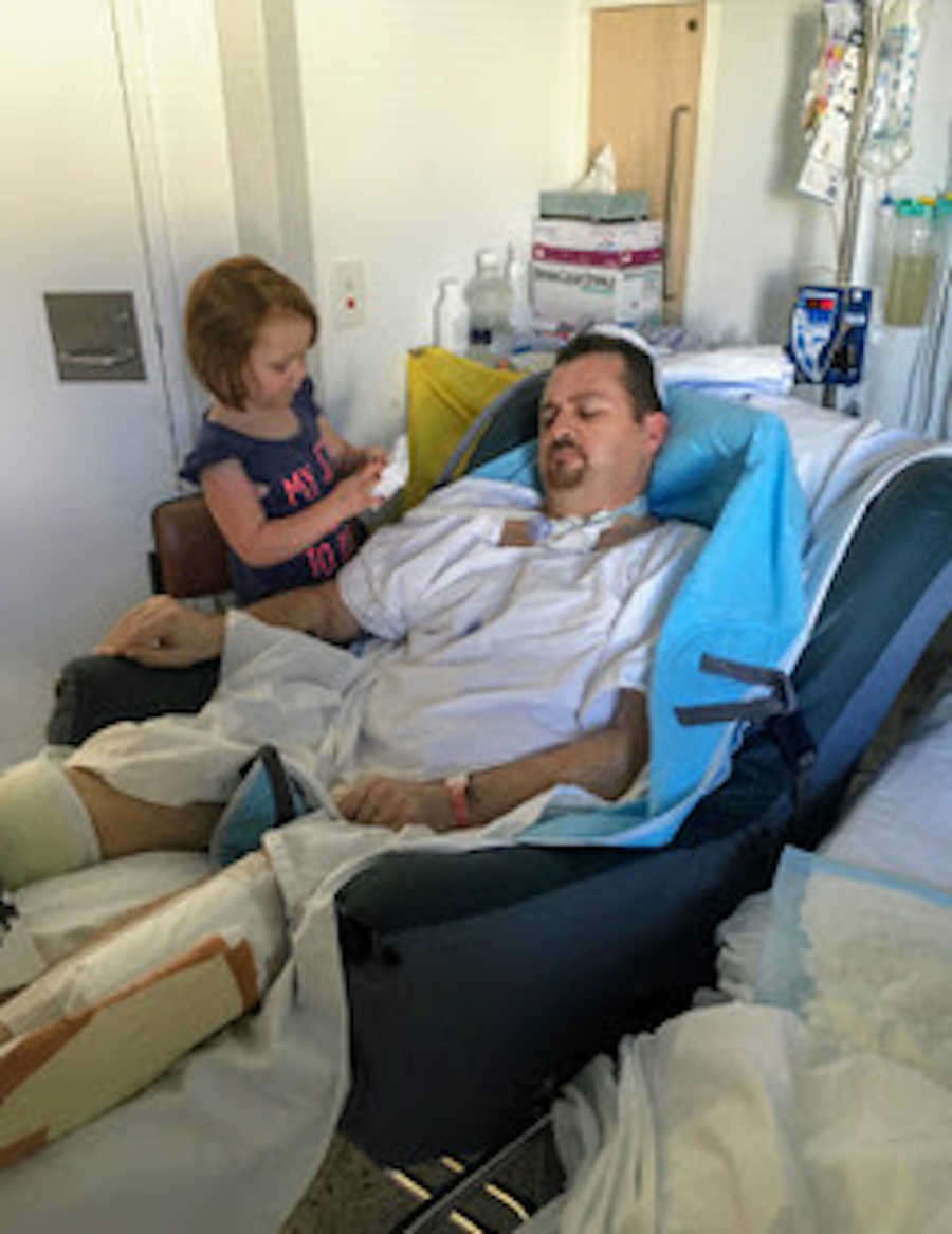 Father in hospital bed and daughter talking to him