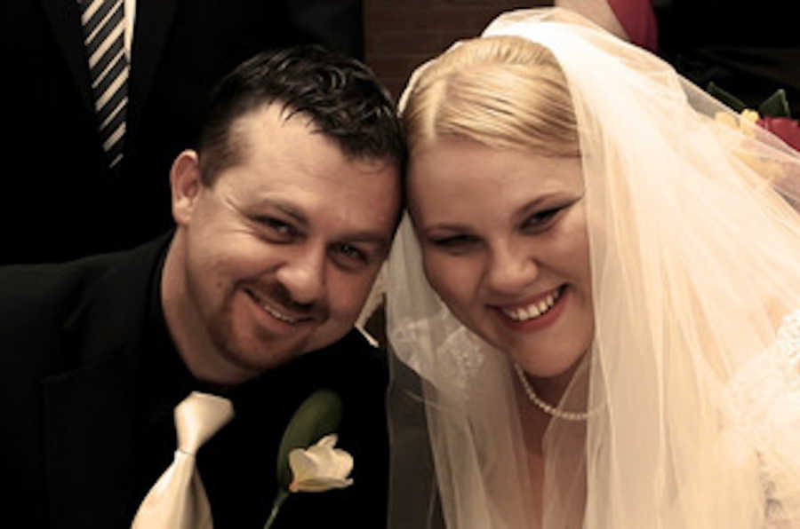 Newlywed coupling taking smiling picture