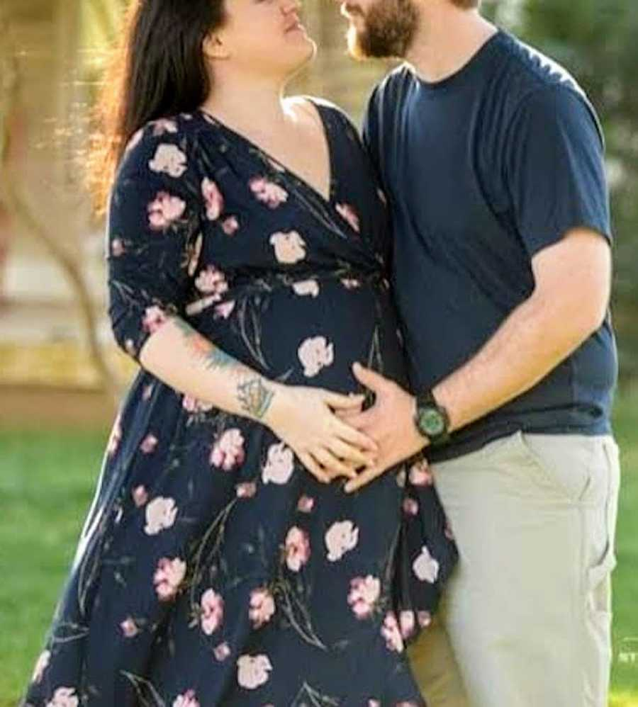maternity photo of couple embracing