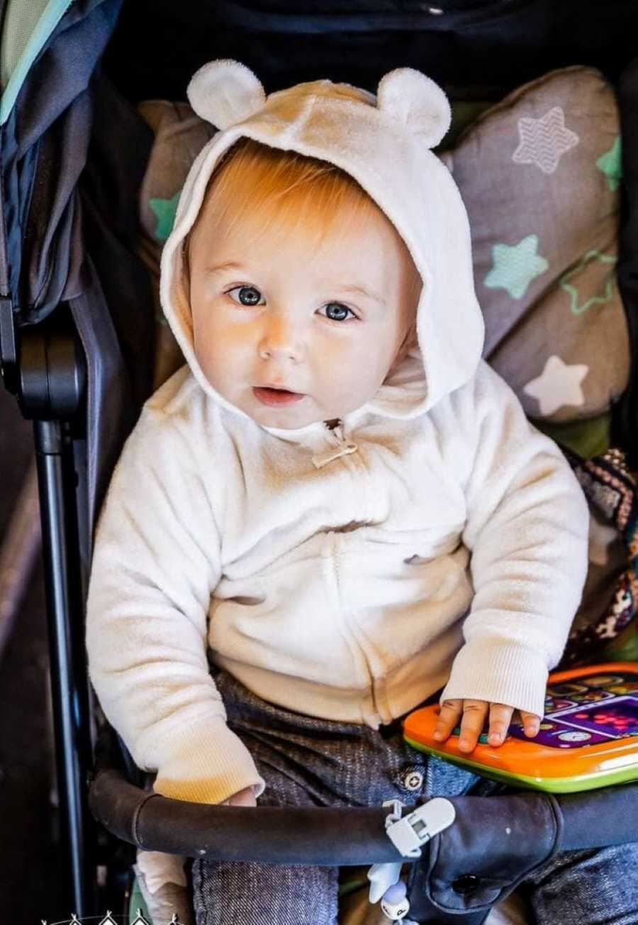 First time mom takes photo of her son in his stroller with a fuzzy jacket on