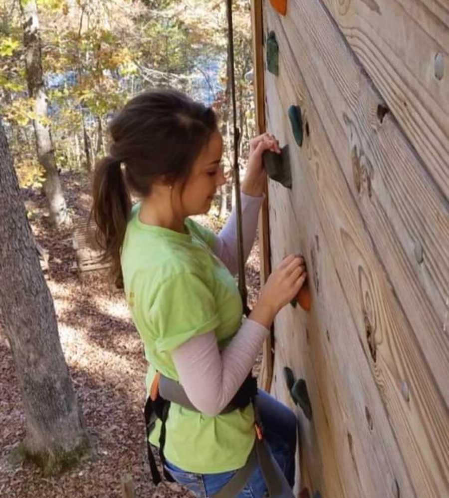 young woman rock climbing