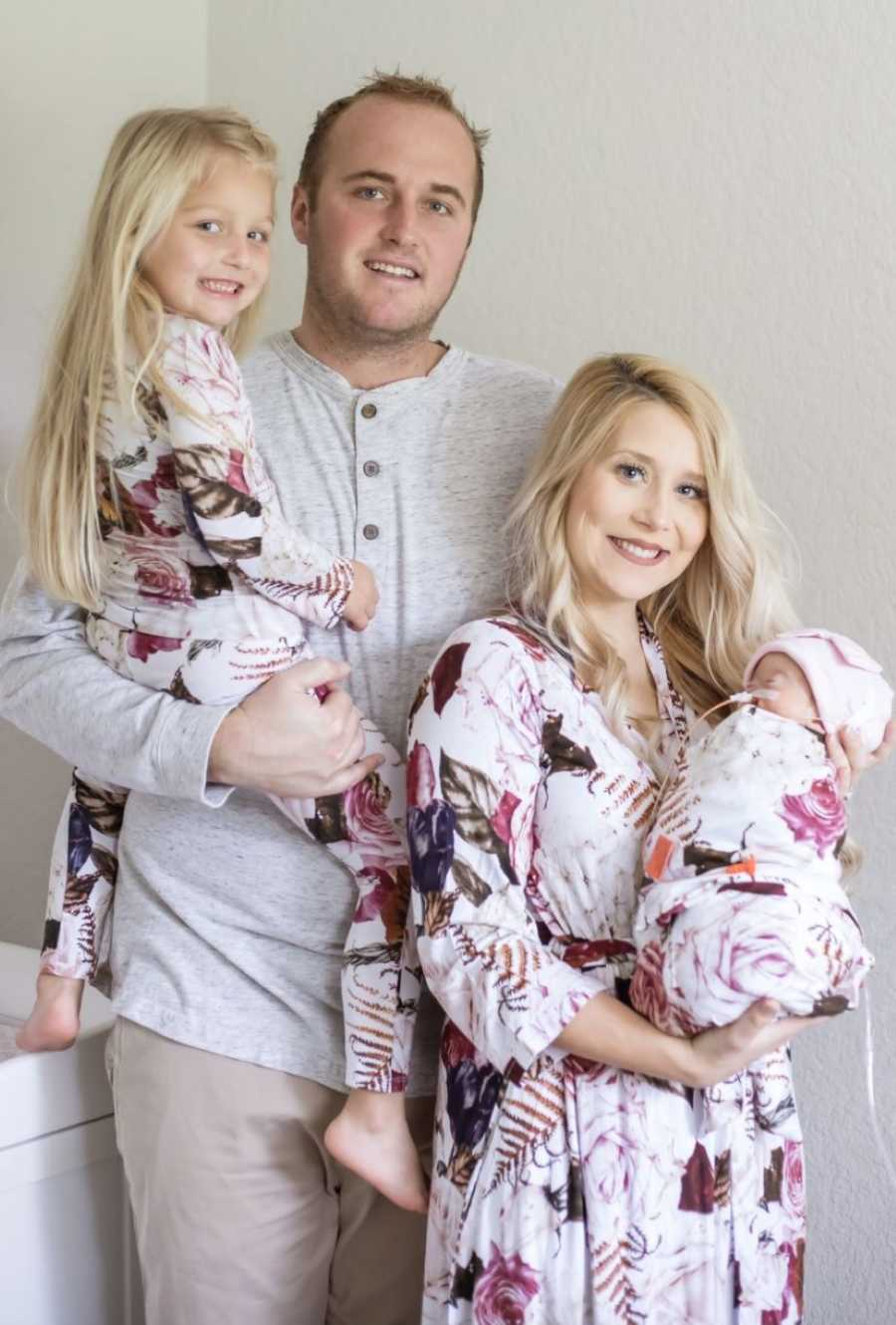 Family of four take photos in matching outfits to celebrate the life of their newborn baby girl