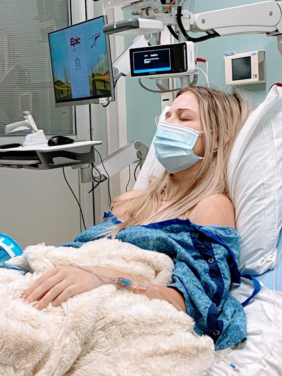 Pregnant woman battling Hyperemesis Gravidarum rests during one of her many hospital stays