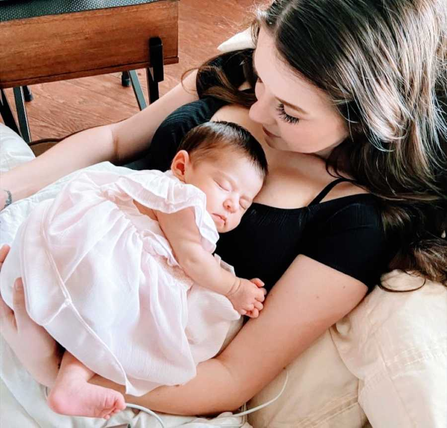 First time mom takes photo with her sleeping newborn daughter during photoshoot after surviving rare HG pregnancy