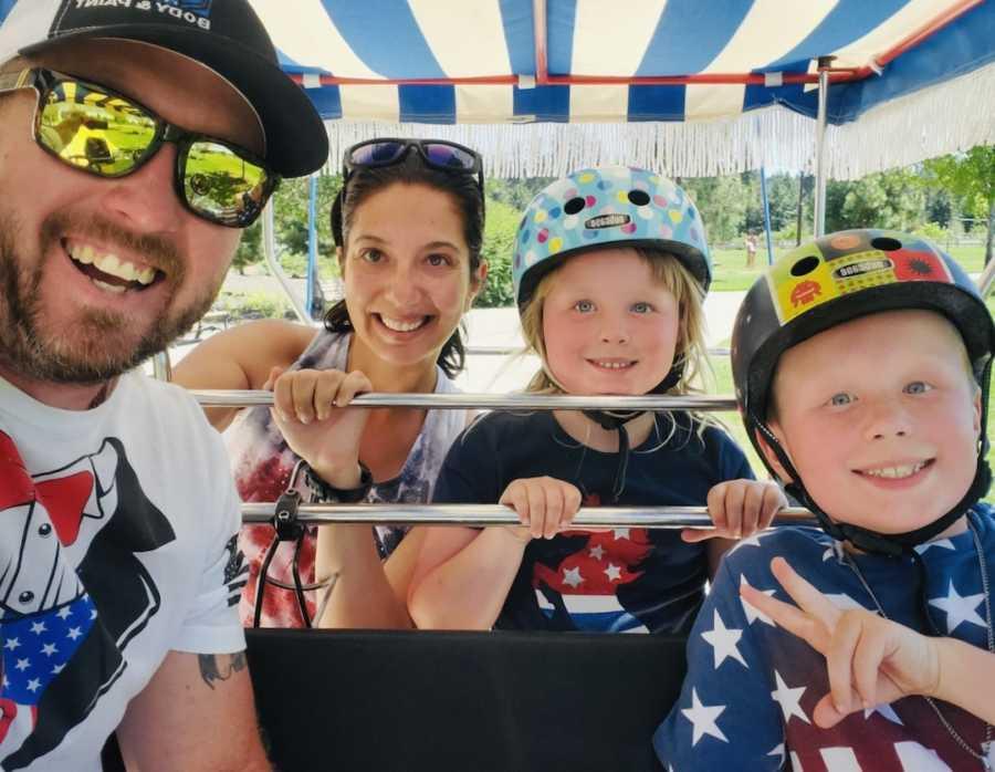 family on amusement park ride