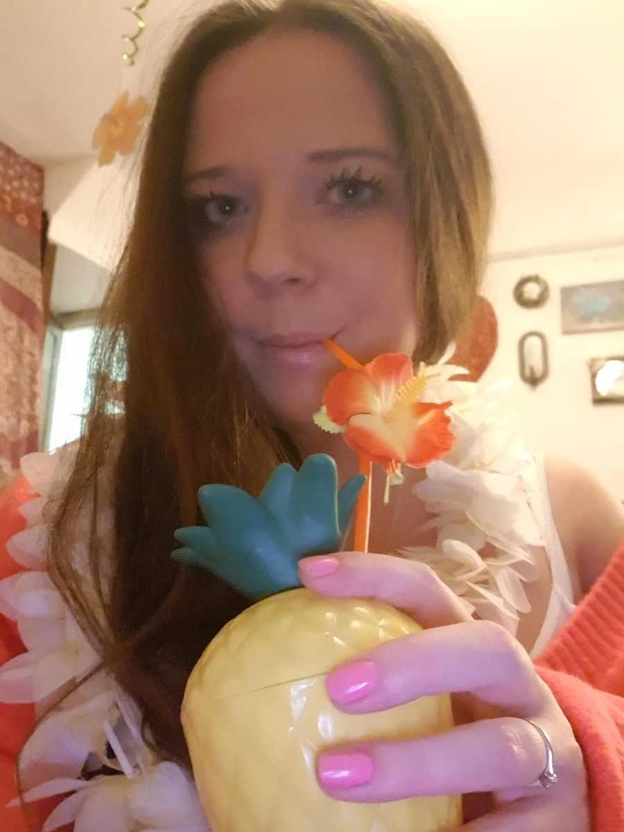 woman holding flowery drink
