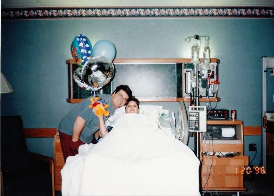 First time parents take photo together in the hospital before wife gives birth