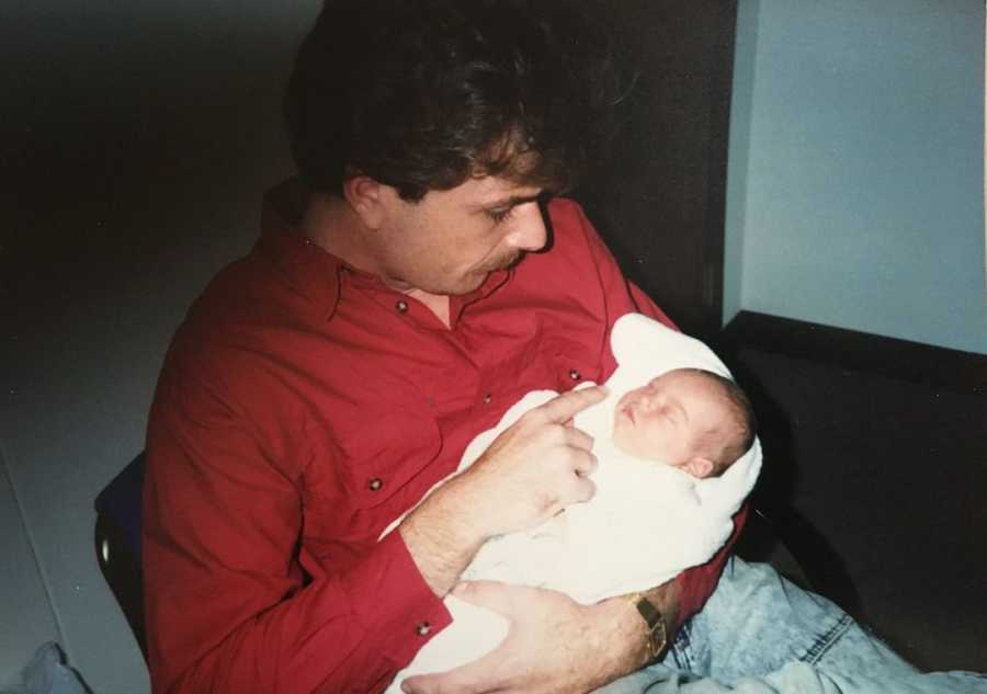 birth father holding daughter