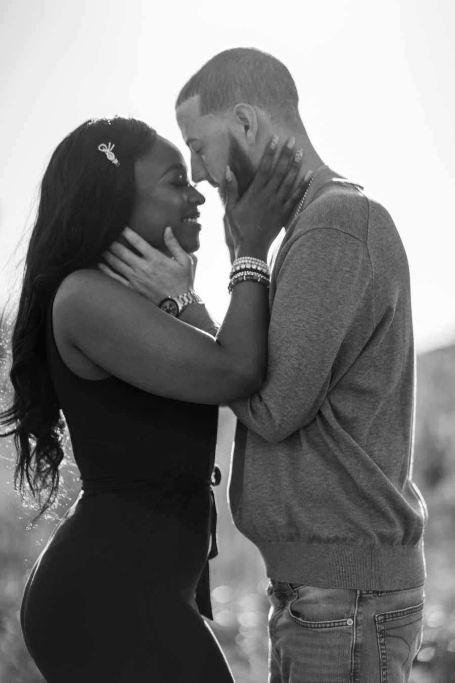 Young interracial couple share sweet, intimate moment during photoshoot