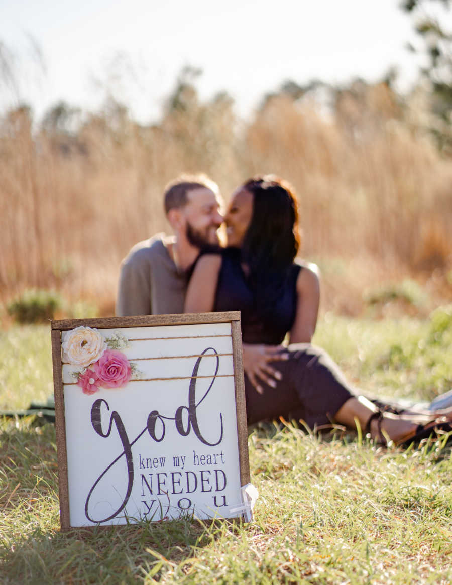 """Married couple battling cancer take a photo with a sign that says """"God knew my heart needed you"""""""