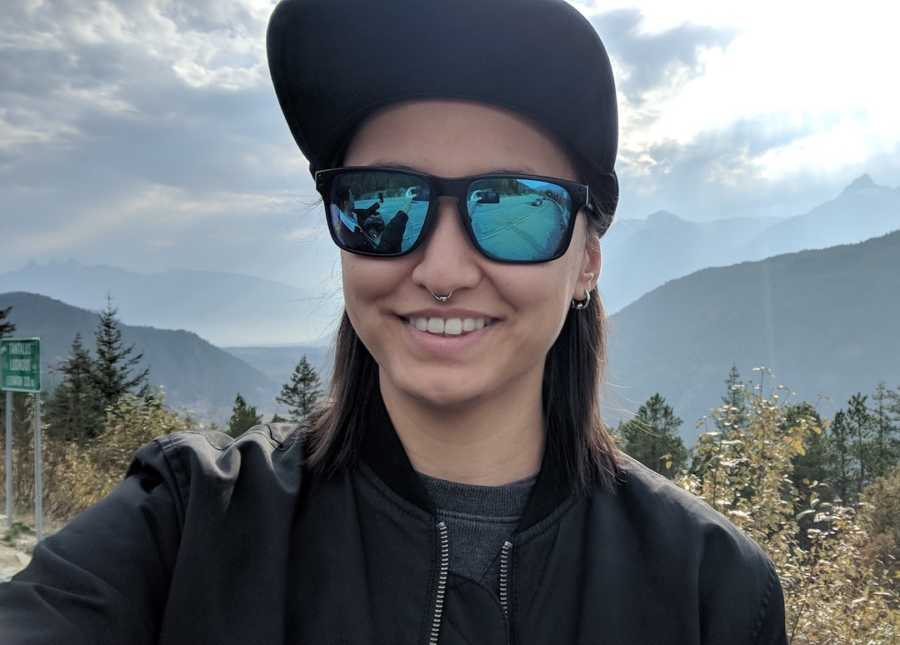 woman smiling on mountains