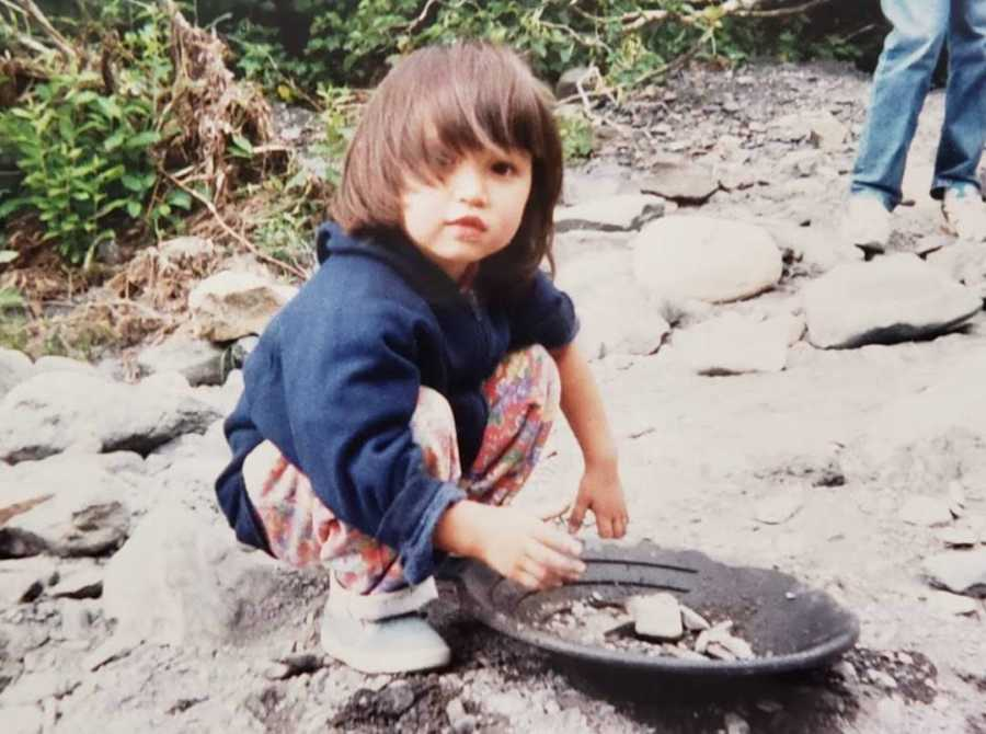 young girl playing with sand