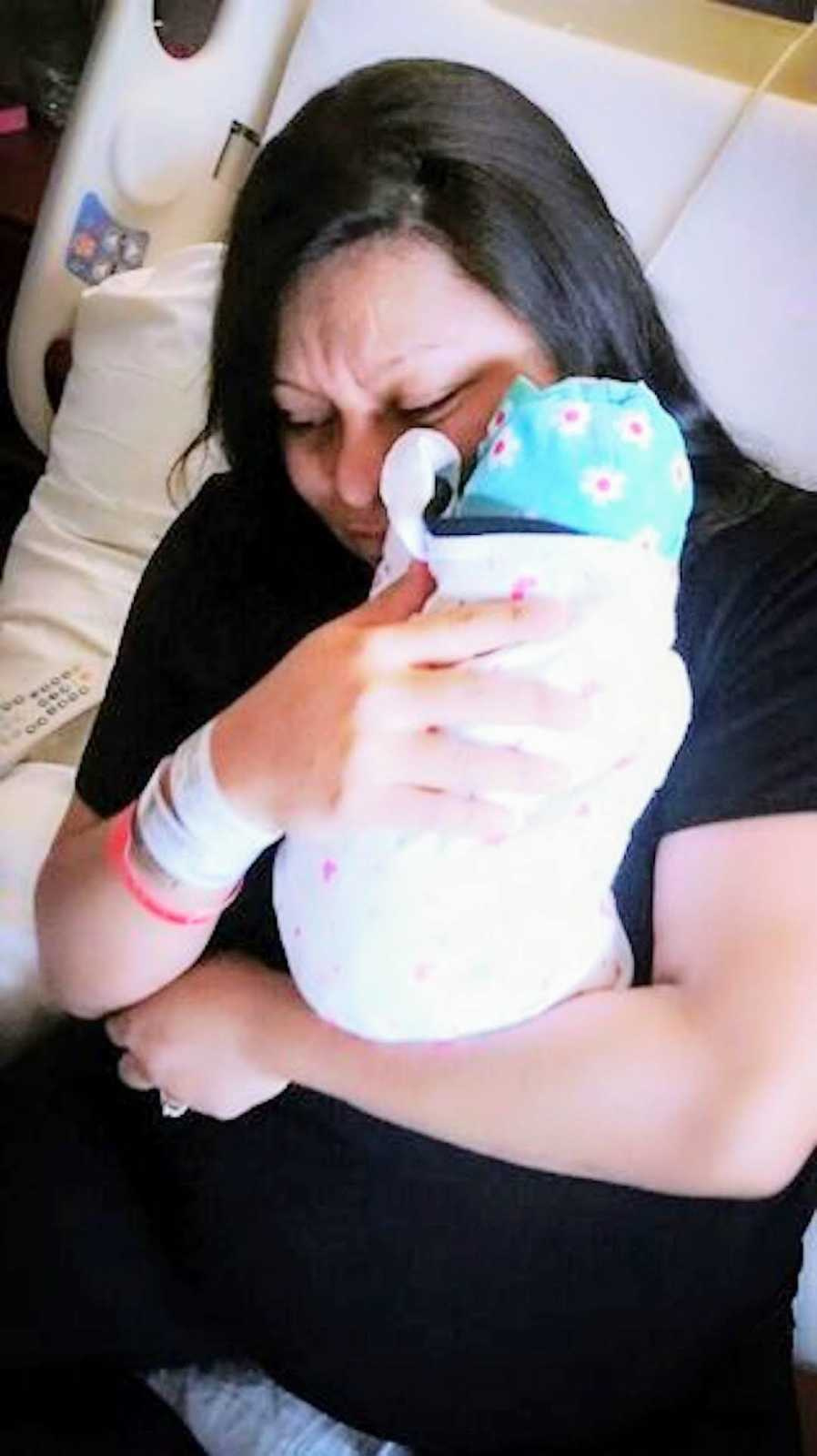 mom holding her newborn baby
