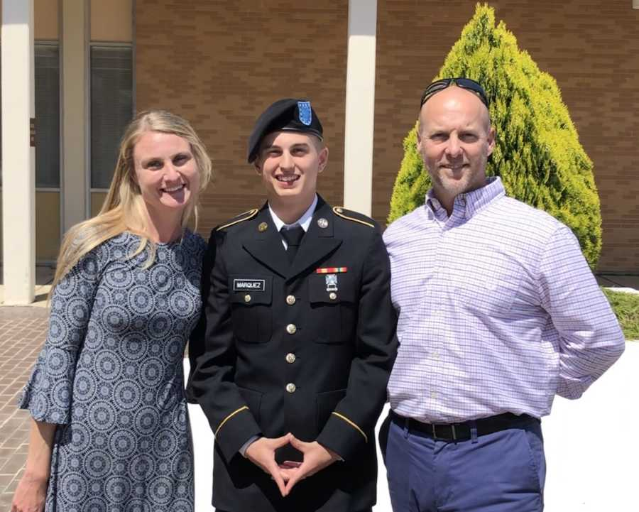 parents with their son in an army uniform